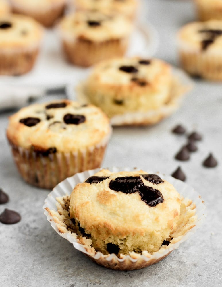 low carb chocolate chip banana bread muffins atop a marble kitchen counter