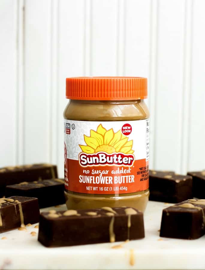 chocolate-bar-fat-bombs beside a jar of sunbutter