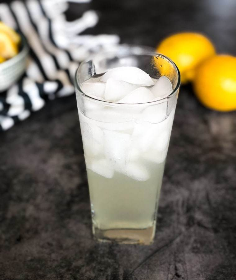 close up image of a glass of keto lemonade atop a wooden table
