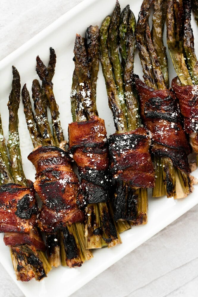 overhead shot of bacon wrapped maple parmesan asparagus bundles keto and nut free