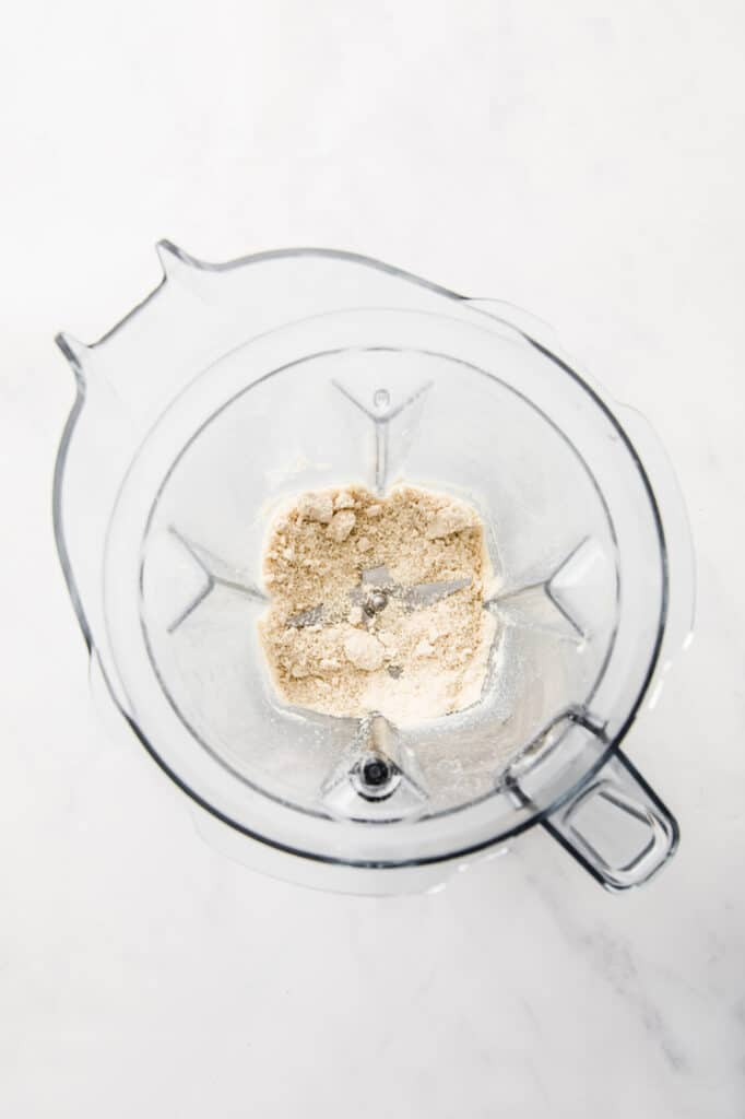overhead sesame seeds in a blender, pulsed until ground