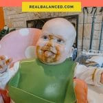 Introducing Baby To Solid Foods coral colored Pinterest Pin image
