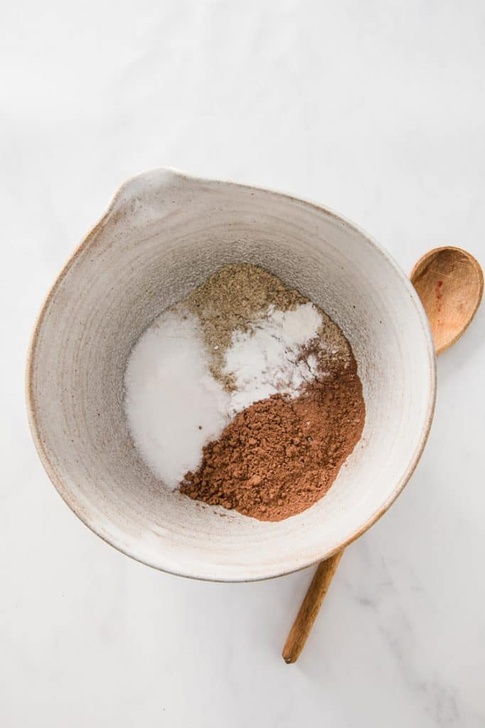 a bowl of dry ingredients atop a marble kitchen counter