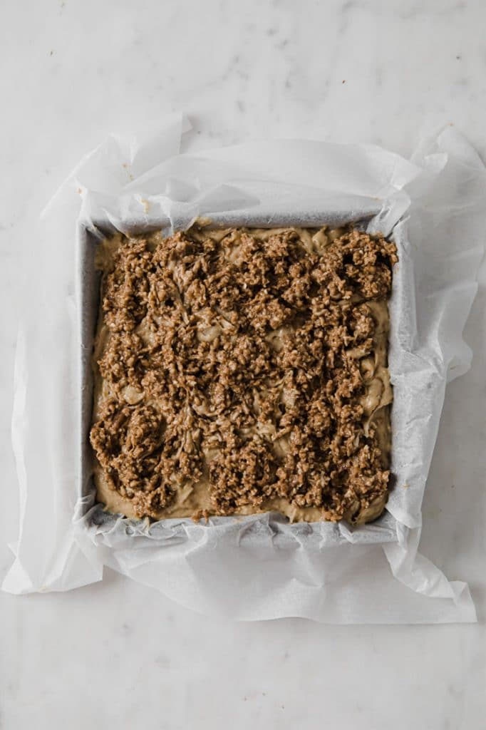 baking pan with parchment paper containing keto coffee cake