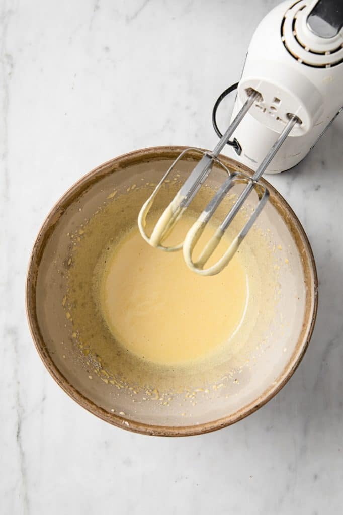 egg yolk and monk fruit sweetener whisked with an electric mixer until smooth in a mixing bowl