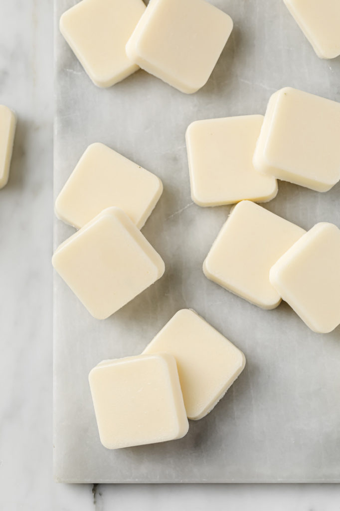 overhead image of Marshmallow Fat Bombs scattered atop a marble kitchen table