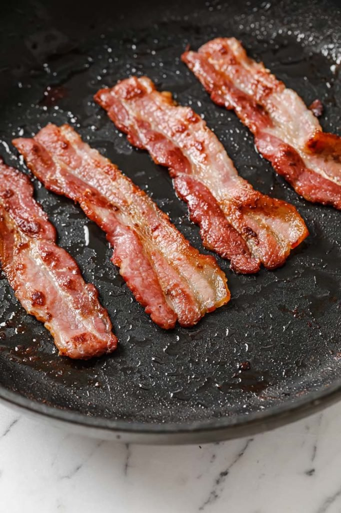 cooked crispy bacon in skillet